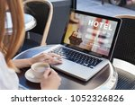 booking hotel on internet ... | Shutterstock . vector #1052326826