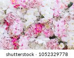 colorful flowers wall background | Shutterstock . vector #1052329778