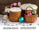 easter cake and easter eggs in... | Shutterstock . vector #1052331959