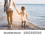 mothers  hand lead his  little... | Shutterstock . vector #1052335310