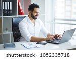 handsome businessman working on ...   Shutterstock . vector #1052335718
