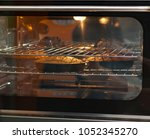 three carrot cakes in the oven  ... | Shutterstock . vector #1052345270