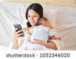 newborn concept. mother and... | Shutterstock . vector #1052346020