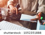asian man working with... | Shutterstock . vector #1052351888