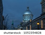 Marche Bonsecours in Montreal, Quebec, Canada, during a winter evening, surrounded by other historical buildings. Bonsecours Market is one of the main attractions of Old Montreal
