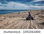 man sitting on atv all terrain... | Shutterstock . vector #1052361800