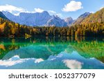 fusine lake with mount mangart... | Shutterstock . vector #1052377079