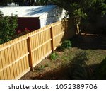 new wooden fence between houses ... | Shutterstock . vector #1052389706