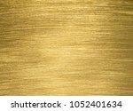 gold texture background | Shutterstock . vector #1052401634