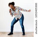 black passionate woman vocalist ... | Shutterstock . vector #1052405300