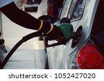 close up worker hand holding... | Shutterstock . vector #1052427020