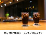 cola with ice and straw in... | Shutterstock . vector #1052451959