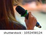 speaker at conference holding... | Shutterstock . vector #1052458124