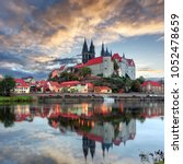 Small photo of Wonderful picturesque Scene. Albrechtsburg Castle in Meissen with Colorful evening sky reflected in calm Water. impressively beautiful Sunset. Unbeatable landscape in the nature. Unsurpassed sunrise.