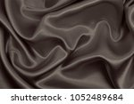 smooth elegant brown silk or... | Shutterstock . vector #1052489684