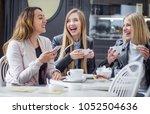 ecstatic girl friends in a... | Shutterstock . vector #1052504636