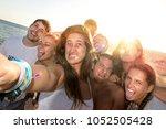 group of happy teenage friends...   Shutterstock . vector #1052505428