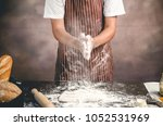 man preparing bread dough on... | Shutterstock . vector #1052531969