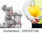 engineering man standing with... | Shutterstock . vector #1052537768
