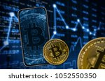 telephone and bitcoin on the... | Shutterstock . vector #1052550350