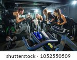 fitness instructor leading... | Shutterstock . vector #1052550509