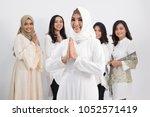 a woman wearing hijab standing... | Shutterstock . vector #1052571419