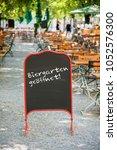 beer garden open sign in munich | Shutterstock . vector #1052576300
