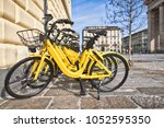 bicycles in public use in the... | Shutterstock . vector #1052595350