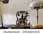 telephone and lamp on the table ... | Shutterstock . vector #1052601014