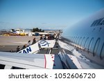 Small photo of Thessaloniki, Greece - March 20, 2018. Passengers board on an Aegean Airlines Airbus A320 at Thessaloniki International Airport.