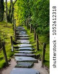 Small photo of A stone path going uphill through the moss in UNESCO World Heritage Rinno-ji Temple in Nikko, Japan