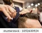 barber cutting customer hair   Shutterstock . vector #1052630924
