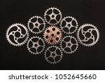rose gold cogwheel surrounded... | Shutterstock . vector #1052645660