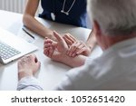 measuring of pulse on wrist by... | Shutterstock . vector #1052651420