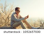 modern man using cellphone in... | Shutterstock . vector #1052657030