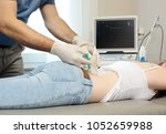 ultrasound guided injection of... | Shutterstock . vector #1052659988