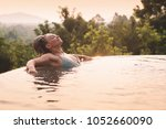 young woman in swimsuit... | Shutterstock . vector #1052660090