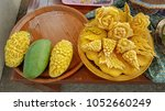 mango and  pumpkin carved on... | Shutterstock . vector #1052660249