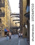 Small photo of Historic walkway through the Shad Thames with brick buildings in Bermondsey - London, Great Britain - 08/01/2015