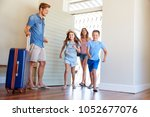 family arriving at summer... | Shutterstock . vector #1052677076