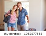 portrait of couple arriving at... | Shutterstock . vector #1052677553