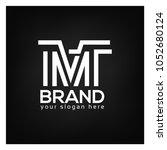letter m and t on black... | Shutterstock .eps vector #1052680124