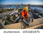 male industry rope access using ... | Shutterstock . vector #1052681870
