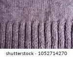 top view of puce knitted fabric ... | Shutterstock . vector #1052714270