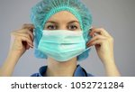 surgeon putting on mask  doctor ... | Shutterstock . vector #1052721284