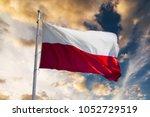 Stock photo polish flag waving against sunset sky 1052729519