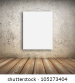 blank picture hanging on wall in room - stock photo