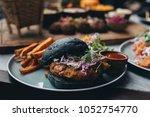 charcoal black bun burger... | Shutterstock . vector #1052754770