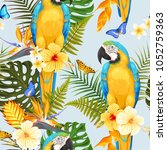 seamless macaw and flowers | Shutterstock .eps vector #1052759363