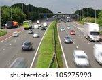 heavy traffic moving at speed... | Shutterstock . vector #105275993